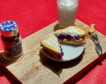 Miniature peanut butter and grape jelly sandwich