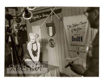 VINTAGE PHOTOGRAPH - DeJUR Cameras - Camera Club photographers with Strangely Beautiful Girl at a 1950's Camera Show -