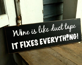 wine is like duct tape it fixes everything, wood sign