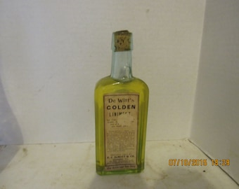 1890's EC Witt & Co Chicago, Ill Golden Liniment 6 7/8 inch aqua medicine bottle with paper label