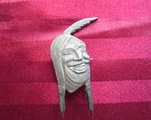 Saved for banjomike: Rare Vintage Indian Motorcycle Laughing Face Pin by W&H. Co