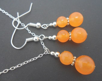 A hand made orange jade beads   necklace and  earring set.
