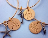hand stamped bangle bracelet with dangle charm in silver or gold