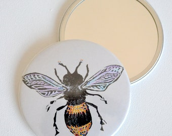 Bee 76mm Pocket Mirror. A colourful Bee mirror to Bee Beautiful. A mirror perfect for pockets and handbags and Bee lovers