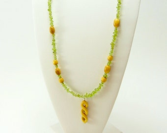 Celtic hand carved pendant necklace with yellow wood and green stone beads