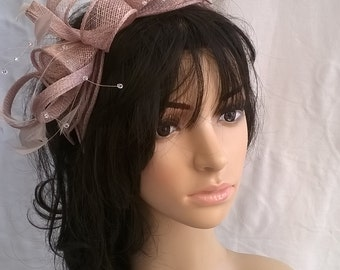Oyster pink rosette fascinator with crystal stamens..on a headband