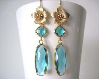 long gold earrings with aqua glass
