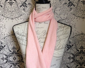 Peach embossed infinity/loop scarf. This design is called the Cleo