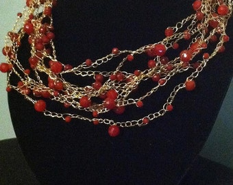 Red and gold crocheted wire necklace