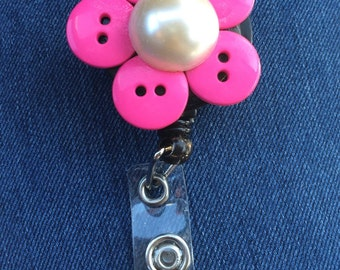 Pink Flower Retractable ID badge reels.
