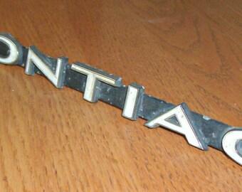 Vintage Metal Pontiac Emblem