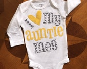 Personalized and appliquéd I heart my auntie onesie in a modern gray fabric with a yellow heart