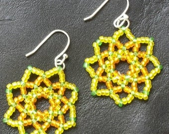 Flower beaded earrings, yellow and orange with a hint of green.