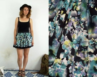 90's vintage women's  black high waisted mini skirt with blue-purple flower patterns