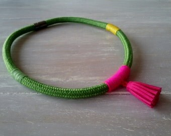 OMAHA. Green rope necklace with pink suede tassel and wrapped yarn