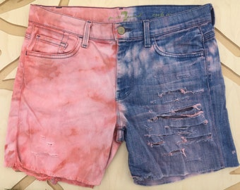 Half and half cutoff destroyed denim shorts.
