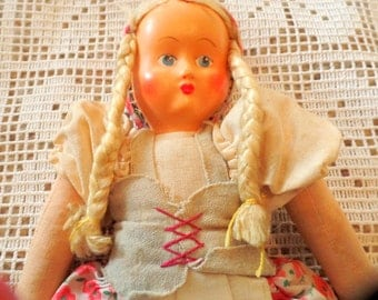 Vintage, 1940s-50s cloth doll, with plastic mask face.