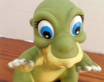 "Baby Dino rubber, soft toy.  5 1/2""."