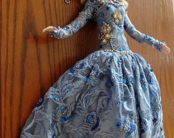 1995 Showstoppers all porcelain showgirl doll.  She is costumed for the stage in a blue satin gown