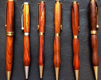 Hand Made Wooden Pens carved per order.  As these are hand turned, there are going to be variances in both shape and color.