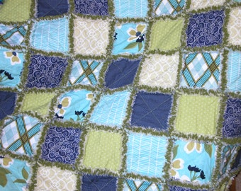 Blue and green adult sized rag quilt throw
