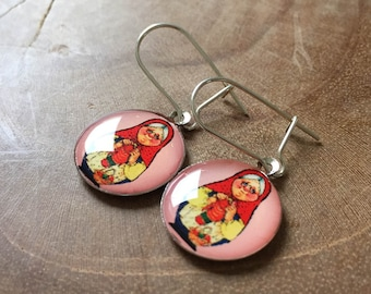 Dangeling Matryoshka earrings: pink, yellow and red.