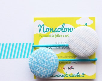Hair elastics made with cloth-covered buttons.