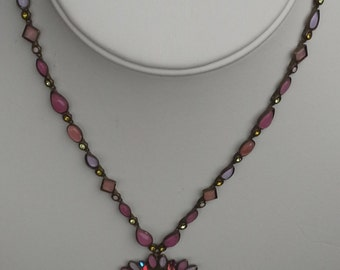 Sorrelli Multicolor crystal encrusted cabochons necklace pendant on bronze tone chain.