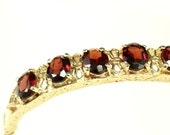 14K Gold Hinged Bracelet with Oval Garnets