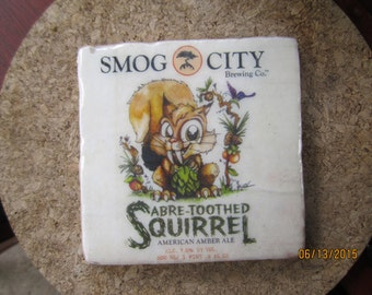 Smog City Brewery, Sabertooth Squirrel. Marble Coaster. Torrance California.