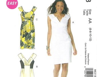 Uncut McCall's Sewing Pattern 6318; Misses' Lined Dresses,           Three styles to choose from. Sizes 6-8, 10-12.  New Factory Folded