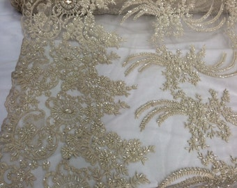 Dark ivory french design embroidered and heavy beaded on a mesh lace.36x50inches. Bridal-wedding fabric lace. Sold by the yard.