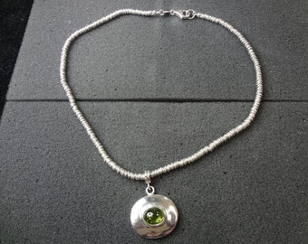 Sterling Silver Oval Pendant with a Light Green Stone