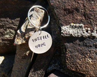 """Handstamped """"instill hope"""" keychain"""