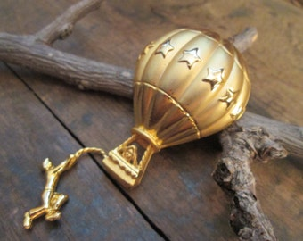 vintage gold tone ajc balloon with hanging man brooch