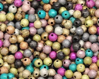 100 Assorted Stardust Acrylic Beads 8mm.  Ideal for jewellery, decoration,