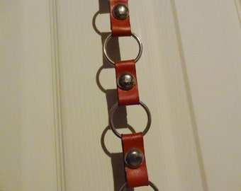 Vintage Woman's Red Faux Leather Hoop Belt with Silver Tone Buckle and Hoops - S/M