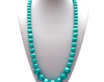 Silicone Teething Necklace - Anna made with Flat Ovals and 12 mm beads in your choice of colors.