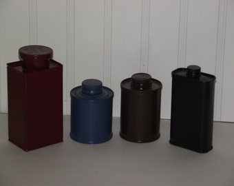 Four vintage tin can containers, recently repainted, in very good condition. One from 1943.