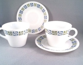 Two pyrex checkers cups and saucers