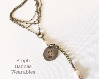 Extra long LET IT BE necklace. Hand stamped with fresh water pearl and copper details in bronze. Rosary style necklace
