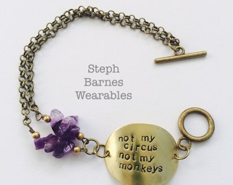 NOT MY CIRCUS not my monkeys bracelet in bronze with amethyst detail.
