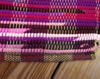 shades of purple with black accents handwoven rag rug made from recycled t-shirts