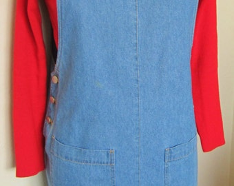 Denim Blue Jumper-it features 2 button adjustable straps & has 2 front pockets.It was sewn with orange thread and has 3 buttons on each side