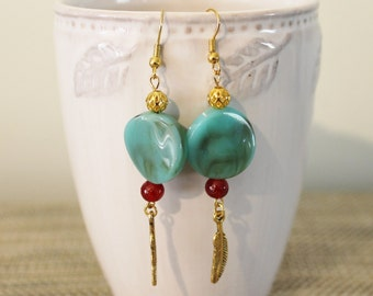 Gold toned and turquoise coloured feather boho earrings