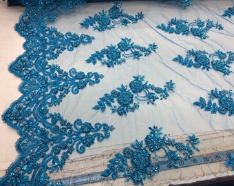 Bridal wedding turquoise beaded fabric mesh lace. Sold by yard.