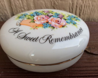 This is a 'Sweet Remembrance'  Porcelain Trinket Box, Avon.