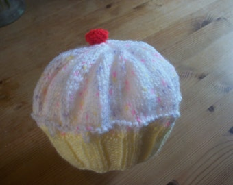 Hand knit cupcake hat. Double knit yarn. To fit 0-3 months.