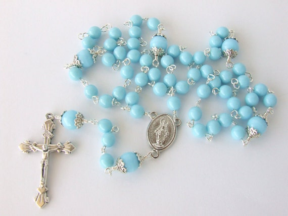 Catholic rosary beads miraculous medal centerpiece sky