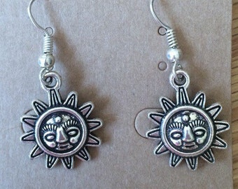 Silver tone sun earrings